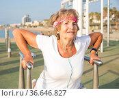 Aged lady exercising outdoors. Стоковое фото, фотограф Татьяна Яцевич / Фотобанк Лори