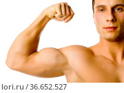 Closeup of male flexed arm and face. Isolated on white in studio. Стоковое фото, фотограф Zoonar.com/Tomasz Trojanowski / easy Fotostock / Фотобанк Лори
