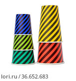 Stack of paper disposable striped cups isolated on white background... Стоковое фото, фотограф Zoonar.com/Danko Natalya / easy Fotostock / Фотобанк Лори