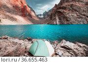 Beautiful serene lake in Fanns mountains (branch of Pamir) in Tajikistan... Стоковое фото, фотограф Zoonar.com/Galyna Andrushko / easy Fotostock / Фотобанк Лори