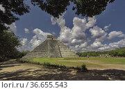 Pyramid of Chichen Itza Filtered by Vegetation. Стоковое фото, фотограф Filippo Carlot / age Fotostock / Фотобанк Лори