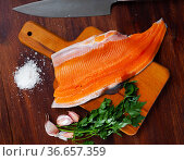 Uncooked fillet trout fish with parsley and garlic. Стоковое фото, фотограф Яков Филимонов / Фотобанк Лори