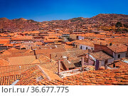 Aerial view of the red tiled roofs of buildings in Cusco, Peru. Стоковое фото, фотограф Zoonar.com/Pawel Opaska / easy Fotostock / Фотобанк Лори
