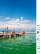 Desenzano, Lombardy, northern Italy, 15th August 2016: Small yachts... Стоковое фото, фотограф Zoonar.com/Serghei Starus / easy Fotostock / Фотобанк Лори
