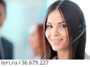 Portrait of a smiling creative businesswoman with earpiece in office. Стоковое фото, фотограф Zoonar.com/Tatiana Badaeva / easy Fotostock / Фотобанк Лори