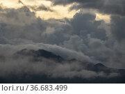 Stormy weather at Gunung Serapi, Matang, Sarawak, East Malaysia. Стоковое фото, фотограф Chua Wee Boo / age Fotostock / Фотобанк Лори