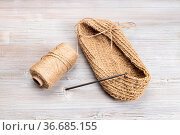 Hemp twine and hand-knitted bottom of bag with crochet on wooden table. Стоковое фото, фотограф Zoonar.com/Valery Voennyy / easy Fotostock / Фотобанк Лори