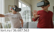 Caucasian boy with brother using vr headsets and standing in living room. Стоковое видео, агентство Wavebreak Media / Фотобанк Лори