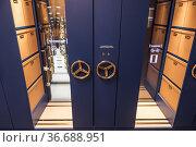 Stockholm, Sweden Turning wheels on a sliding filing cabinet. Стоковое фото, фотограф A. Farnsworth / age Fotostock / Фотобанк Лори