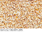 Food background - uncooked wheat groats (crushed partly hulled wheat... Стоковое фото, фотограф Zoonar.com/Valery Voennyy / easy Fotostock / Фотобанк Лори