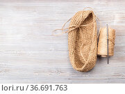 Hemp twine and hand-knitted bottom of bag on wooden table with copyspace... Стоковое фото, фотограф Zoonar.com/Valery Voennyy / easy Fotostock / Фотобанк Лори