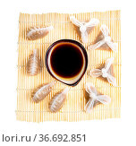 Chinese cuisine - top view of various Dim sum and soy sauce in bowl... Стоковое фото, фотограф Zoonar.com/Valery Voennyy / easy Fotostock / Фотобанк Лори