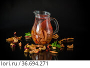 sweet cool compote boiled from various dried fruits, in a glass decanter. Стоковое фото, фотограф Peredniankina / Фотобанк Лори