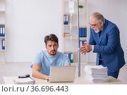 Young male employee feeling bad at workplace. Стоковое фото, фотограф Elnur / Фотобанк Лори