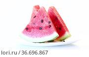 Pieces of fresh ripe red watermelon on white. Стоковое видео, видеограф Peredniankina / Фотобанк Лори