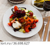 Salad with beetroot, greens and fresh cheese. Стоковое фото, фотограф Яков Филимонов / Фотобанк Лори