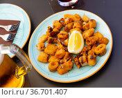 Spanish seafood dish battered fried baby squid. Стоковое фото, фотограф Яков Филимонов / Фотобанк Лори
