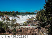 Khone Phapheng Falls at Champasak Province on the Mekong River in... Стоковое фото, фотограф Zoonar.com/Rudolf Ernst / easy Fotostock / Фотобанк Лори