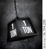 1 ton weight with black chain. 3D illustration. Стоковое фото, фотограф Zoonar.com/Cigdem Simsek / easy Fotostock / Фотобанк Лори