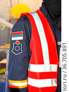 Man in Uniform With Red Reflective Safety Vest. Стоковое фото, фотограф Zoonar.com/Marko Beric / easy Fotostock / Фотобанк Лори