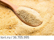 Wooden spoon with granulated coconut sugar close up on pile of sugar. Стоковое фото, фотограф Zoonar.com/Valery Voennyy / easy Fotostock / Фотобанк Лори