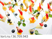 Appetizers, gourmet food - canape with cheese and strawberries, catering... Стоковое фото, фотограф Zoonar.com/Konstantin Malkov / easy Fotostock / Фотобанк Лори