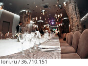 Wedding. Banquet. The chairs and table for guests, served with cutlery... Стоковое фото, фотограф Zoonar.com/Konstantin Malkov / easy Fotostock / Фотобанк Лори