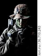 Jagdkommando soldier Austrian special forces with pistol on dark background... Стоковое фото, фотограф Oleg Zabielin / easy Fotostock / Фотобанк Лори