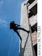 Spec ops police officer SWAT during assault operation. Стоковое фото, фотограф Oleg Zabielin / easy Fotostock / Фотобанк Лори