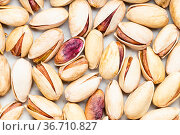Food background - many shelled and ripe pistachio nuts. Стоковое фото, фотограф Zoonar.com/Valery Voennyy / easy Fotostock / Фотобанк Лори