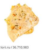 Indian cuisine - pieces of garlic naan (garlicky flatbread) isolated... Стоковое фото, фотограф Zoonar.com/Valery Voennyy / easy Fotostock / Фотобанк Лори