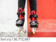 Close-up Of Legs Wearing Roller Skating Shoe, Outdoors urban lifestyle... Стоковое фото, фотограф Zoonar.com/DAVID HERRAEZ CALZADA / easy Fotostock / Фотобанк Лори