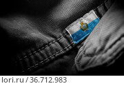 Tag on dark clothing in the form of the flag of the San Marino. Стоковое фото, фотограф Zoonar.com/BUTENKOV ALEKSEY / easy Fotostock / Фотобанк Лори