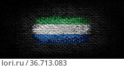 National flag of the Sierra Leone on dark fabric. Стоковое фото, фотограф Zoonar.com/BUTENKOV ALEKSEY / easy Fotostock / Фотобанк Лори
