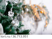 Light from the garlands. Christmas tree decorated ball close-up. Стоковое фото, фотограф Zoonar.com/Konstantin Malkov / easy Fotostock / Фотобанк Лори