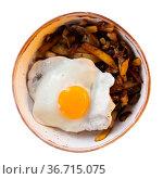 Fried eggs served with roasted potatoes with mushrooms. Стоковое фото, фотограф Яков Филимонов / Фотобанк Лори