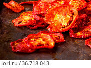 Sun dried tomatoes on dark rustic background. Стоковое фото, фотограф Zoonar.com/Photographer: Andrey N.Cherkasov / easy Fotostock / Фотобанк Лори