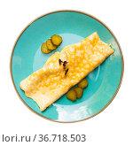 Thin omelette with pickled cucumber garnished with microgreen. Стоковое фото, фотограф Яков Филимонов / Фотобанк Лори