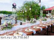 Glasses on the festive table setting. Wedding table decor concept... Стоковое фото, фотограф Zoonar.com/Konstantin Malkov / easy Fotostock / Фотобанк Лори