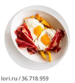 Breakfast of fried eggs with slices of delicious bacon and French fries. Стоковое фото, фотограф Яков Филимонов / Фотобанк Лори