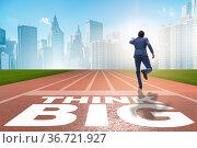 Businessman in think big concept on running track. Стоковое фото, фотограф Elnur / Фотобанк Лори