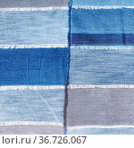 Textile square background - patchwork from various denim flaps. Стоковое фото, фотограф Zoonar.com/Valery Voennyy / easy Fotostock / Фотобанк Лори