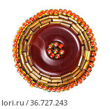 Handcrafted round brown leather brooch decorated by glass beads and... Стоковое фото, фотограф Zoonar.com/Valery Voennyy / easy Fotostock / Фотобанк Лори