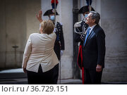 German Chancellor Angela Merkel, Italian Prime Minister Mario Draghi... Редакционное фото, фотограф Alessandro Serrano' / AGF/Alessandro Serrano' / / age Fotostock / Фотобанк Лори