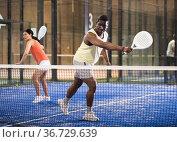 Team of padel players man and woman playing doubles. Стоковое фото, фотограф Яков Филимонов / Фотобанк Лори