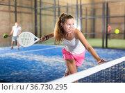 Young beautiful woman with racket playing padel. Стоковое фото, фотограф Яков Филимонов / Фотобанк Лори