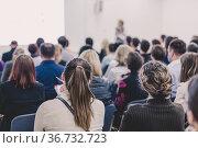 Woman giving presentation on business conference. Стоковое фото, фотограф Matej Kastelic / Фотобанк Лори