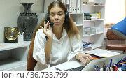 Portrait of smiling polite friendly woman helpline operator with headphones during work in call center. Стоковое видео, видеограф Яков Филимонов / Фотобанк Лори
