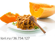 sweet baked pumpkin waffles with honey in a plate. Стоковое фото, фотограф Peredniankina / Фотобанк Лори
