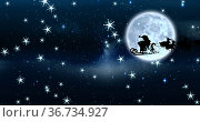 Image of santa claus in sleigh with reindeer at christmas, over snow falling, moon and sky. Стоковое фото, агентство Wavebreak Media / Фотобанк Лори